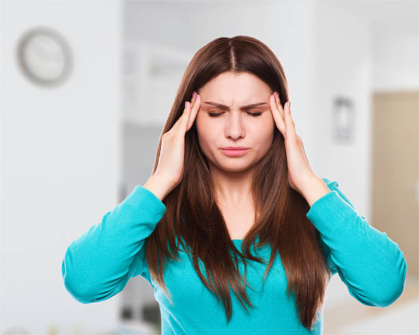 woman with headache, migraine, stress, insomnia, hangover stock photo