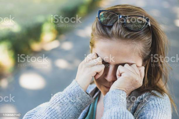 Woman with headache rubbing her eyes outside picture id1206682142?b=1&k=6&m=1206682142&s=612x612&h=5no1 cccd3jwodfmcwa imqh5rsjpxq0gndabjhdlqu=