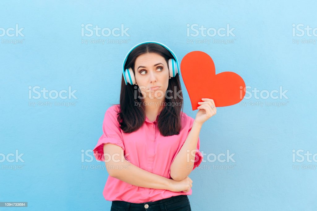 Woman with Headphone Listening to Love Song stock photo