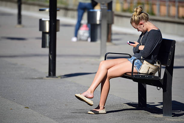 woman with headphones and mobile phone - waiting for a train sweden bildbanksfoton och bilder