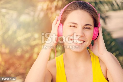 479652946istockphoto Woman with Headphones Outdoors 525967122