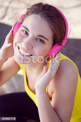 479652946istockphoto Woman with Headphones Outdoors 525967276