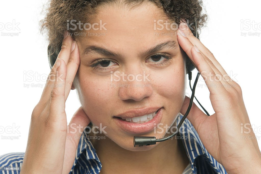 woman with headset having headache royalty-free stock photo