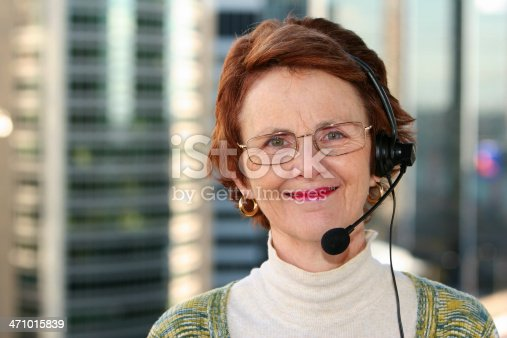 istock Woman with headset. 471015839