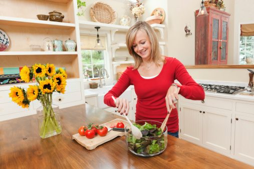 Woman with Healthy Diet Preparing Salad in Contemporary Home Kitchen