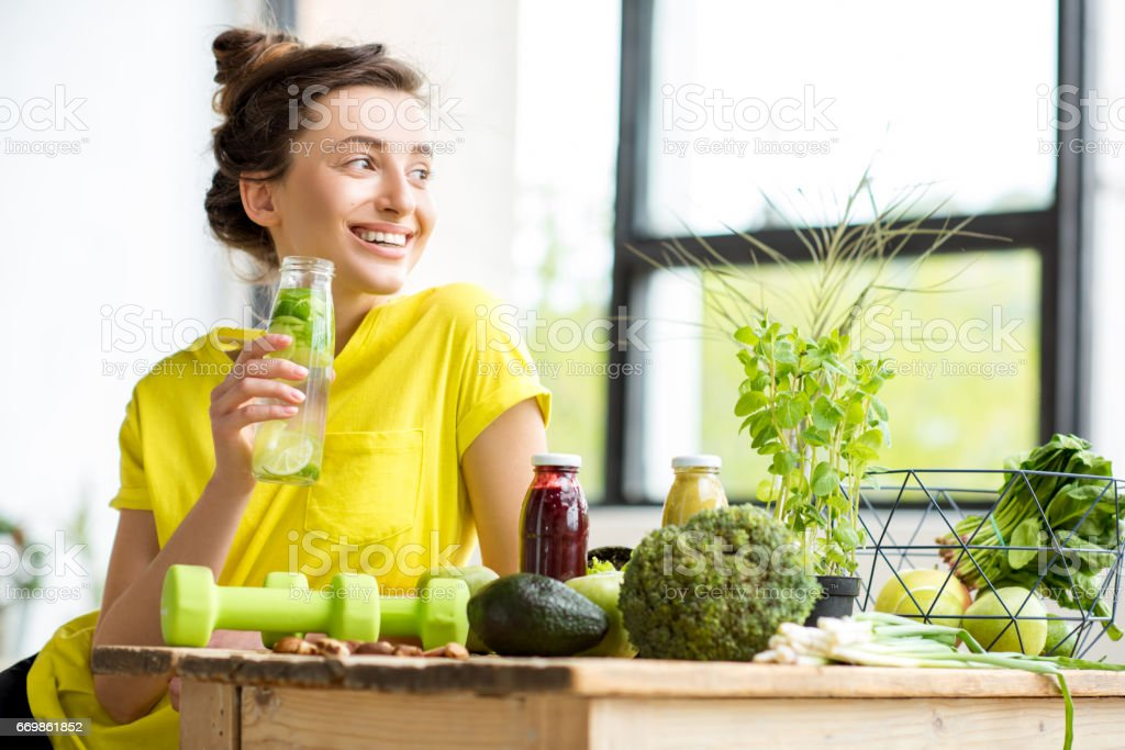 Woman with healthy food indoors stock photo