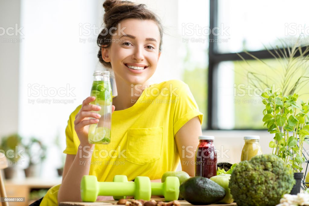 Woman with healthy food indoors – zdjęcie