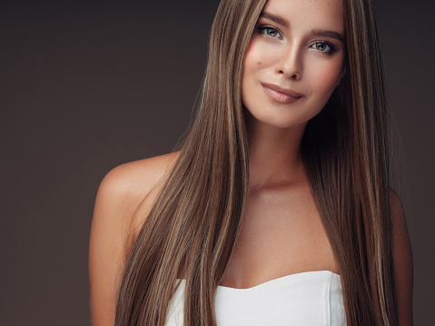 Woman with healthy skin and long hair