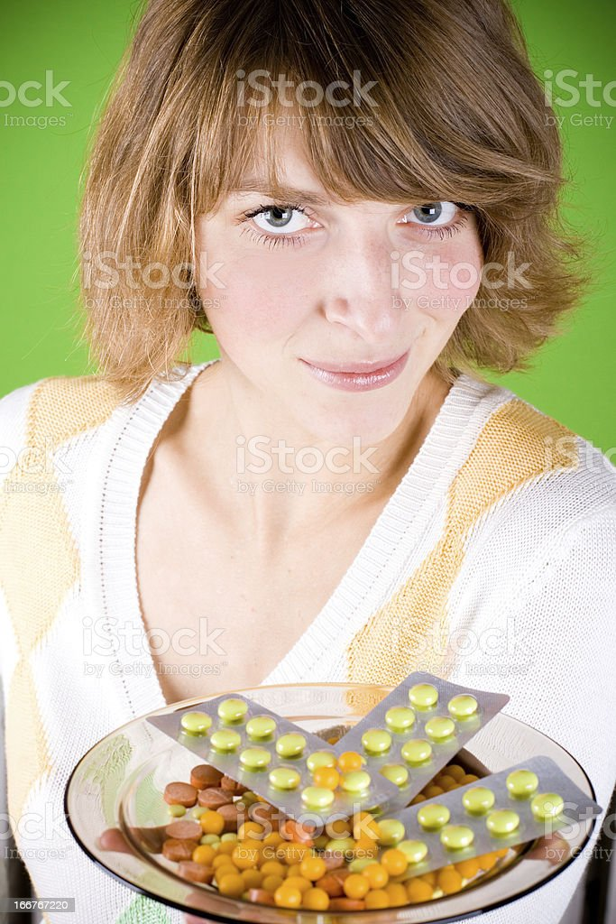 woman with heap of pills royalty-free stock photo