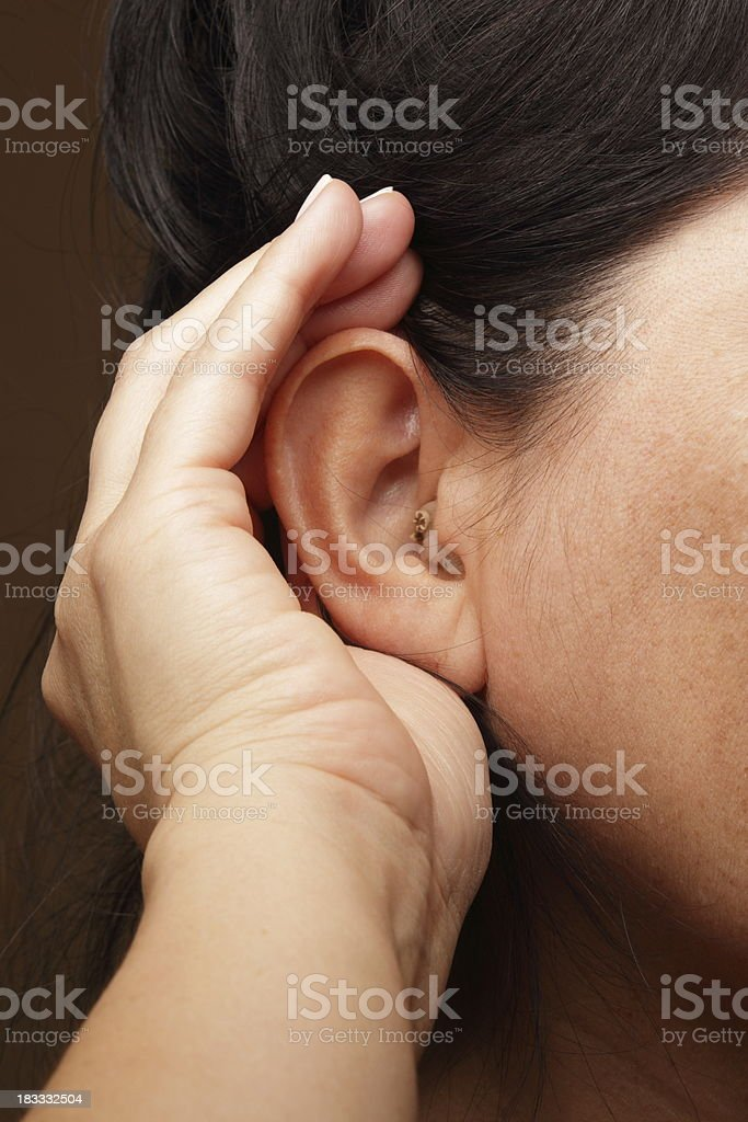 Woman With Hearing Aid Struggles to Hear royalty-free stock photo