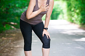 istock Woman with heart attack, injury while running, trauma during workout 1002678430