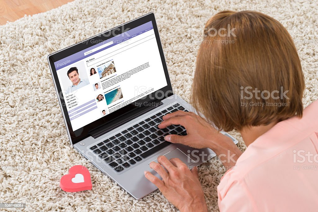 Woman With Heart Sign Chatting On Social Networking Site stock photo