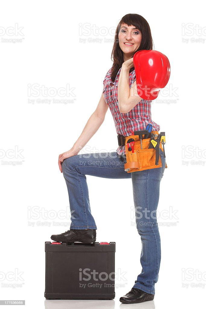 Woman with helmet and belt of tools royalty-free stock photo