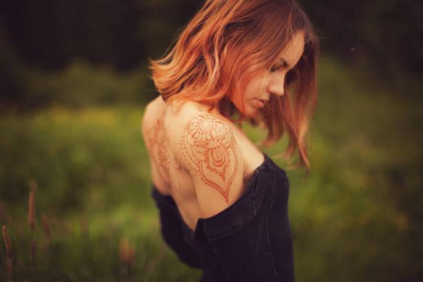Woman with henna tatto stock photo