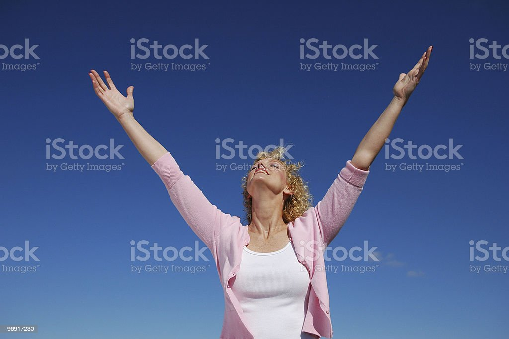 Woman with her arms wide open royalty-free stock photo