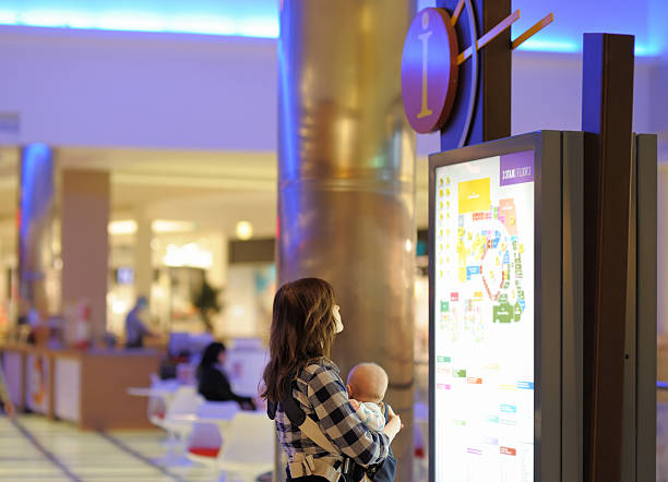 Woman with her baby in a shopping mall stock photo