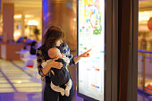 istock Woman with her baby in a shopping mall 536108769