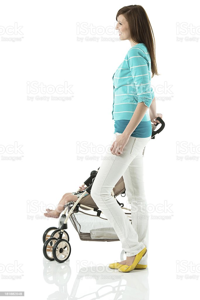Woman with her baby in stroller royalty-free stock photo