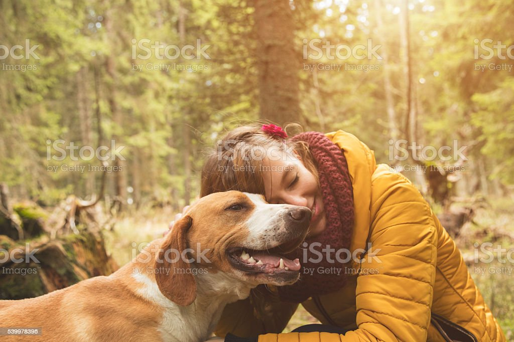 Woman with her beautiful dog in nature. stock photo