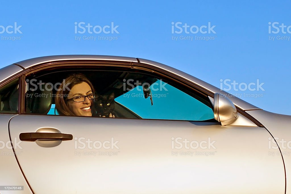 Woman with her cat in the Coupe royalty-free stock photo