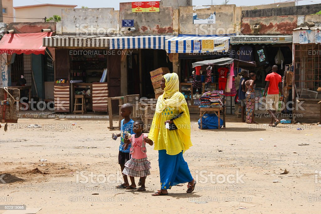 Woman with her children in Dakar, Senegal stock photo