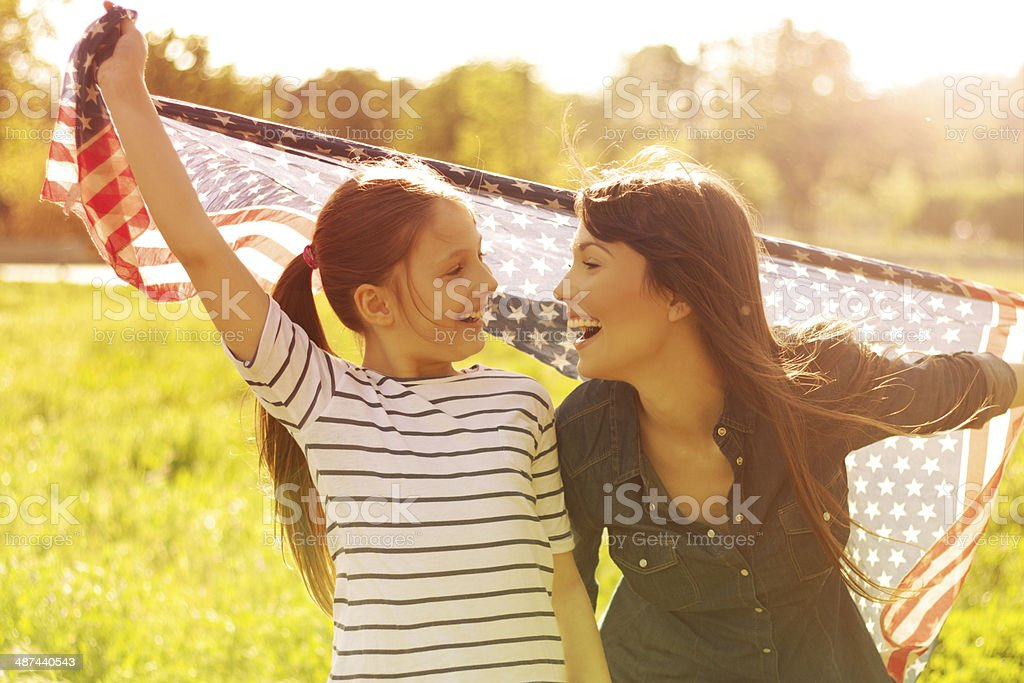 Woman with her daughter enjoying the sun. stock photo