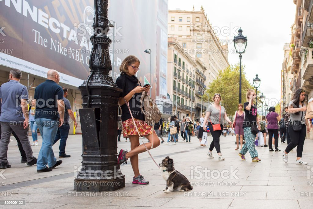 Woman with her dog in Gothic Quarter, Barcelona stock photo