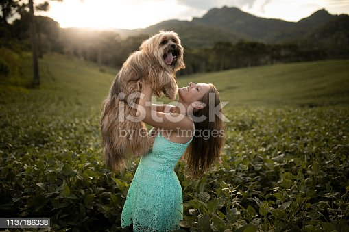 Woman with her dog in nature.