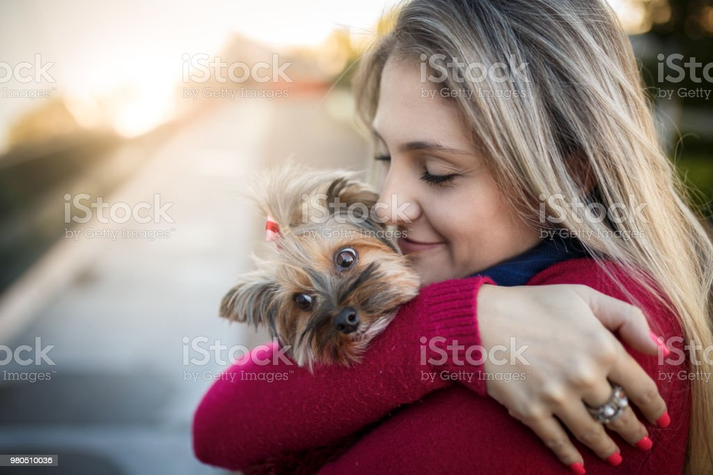 Woman with her dog on pet friendly shopping rooftop