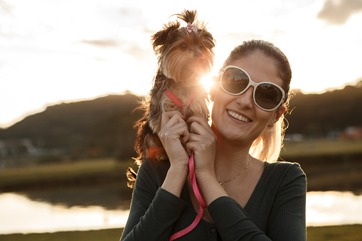 Woman with her dog on shoulder