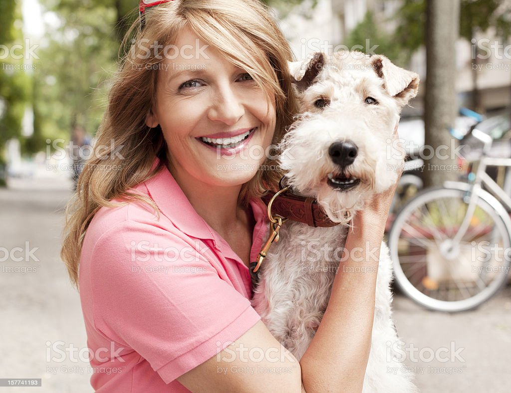 Woman with her fox terrier royalty-free stock photo