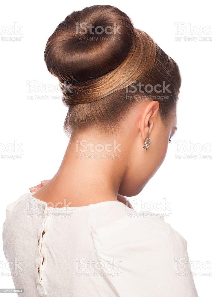 Woman with her hair in an elegant bun stock photo