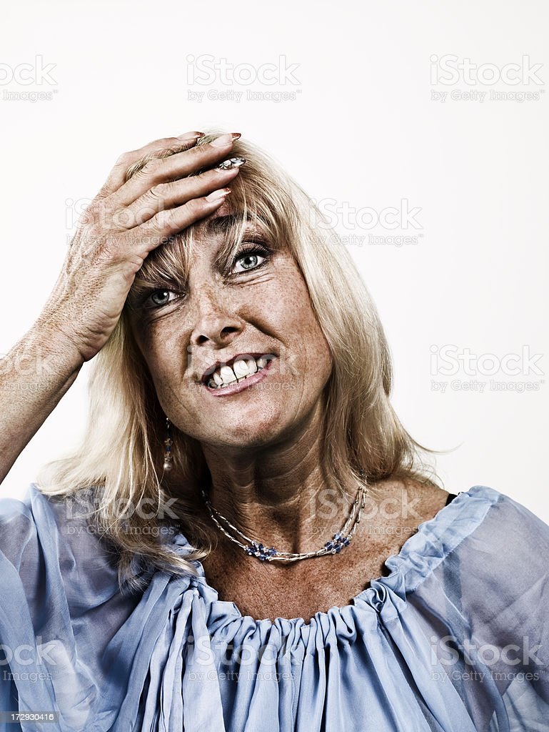 Woman with her hand on the forehead stock photo