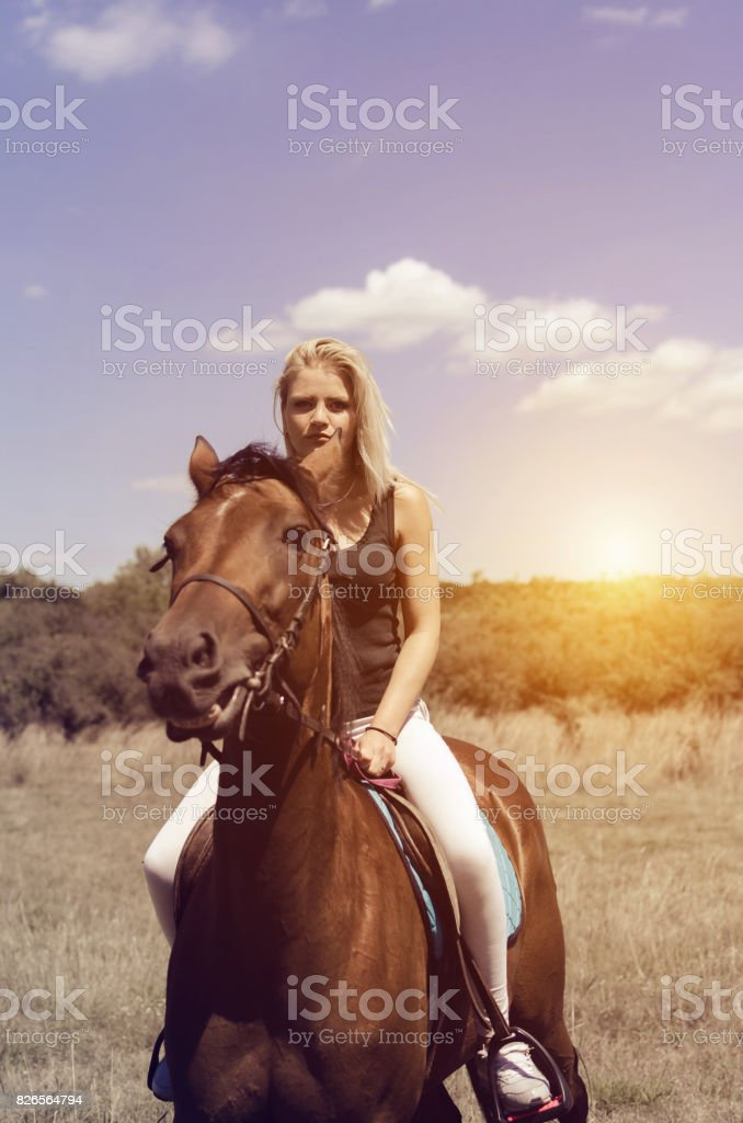 woman with her horse in front of camera stock photo