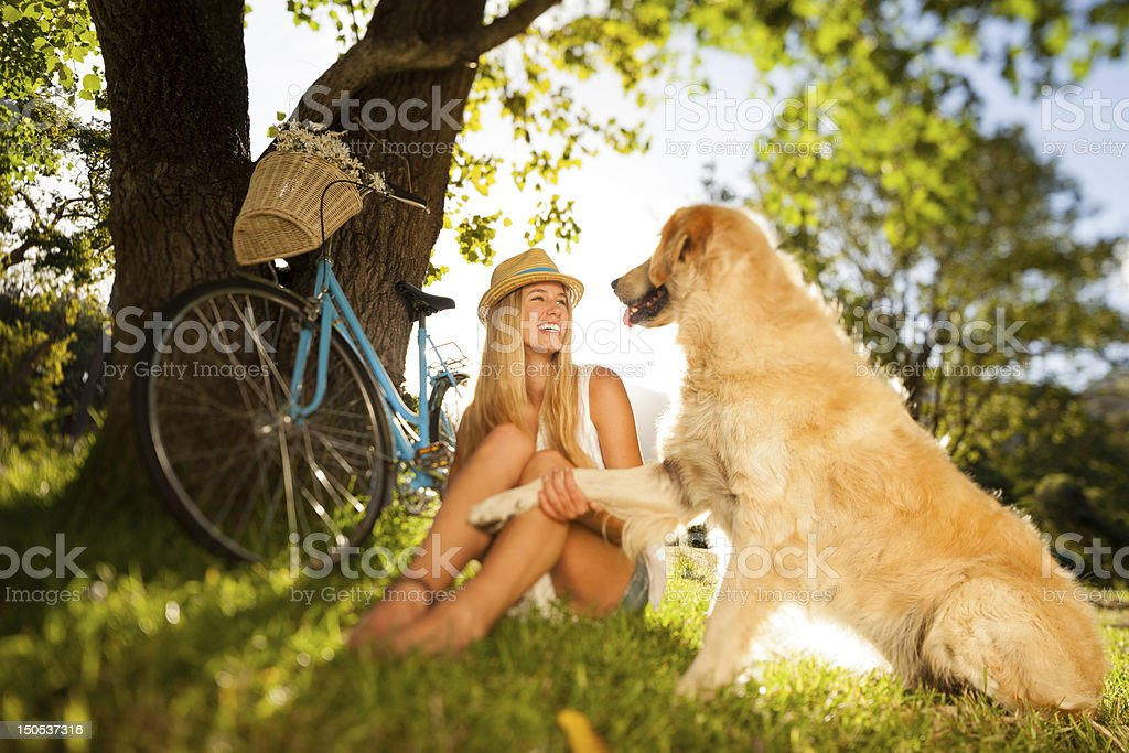 Woman With Her Pet Dog Sitting On Grass royalty-free stock photo