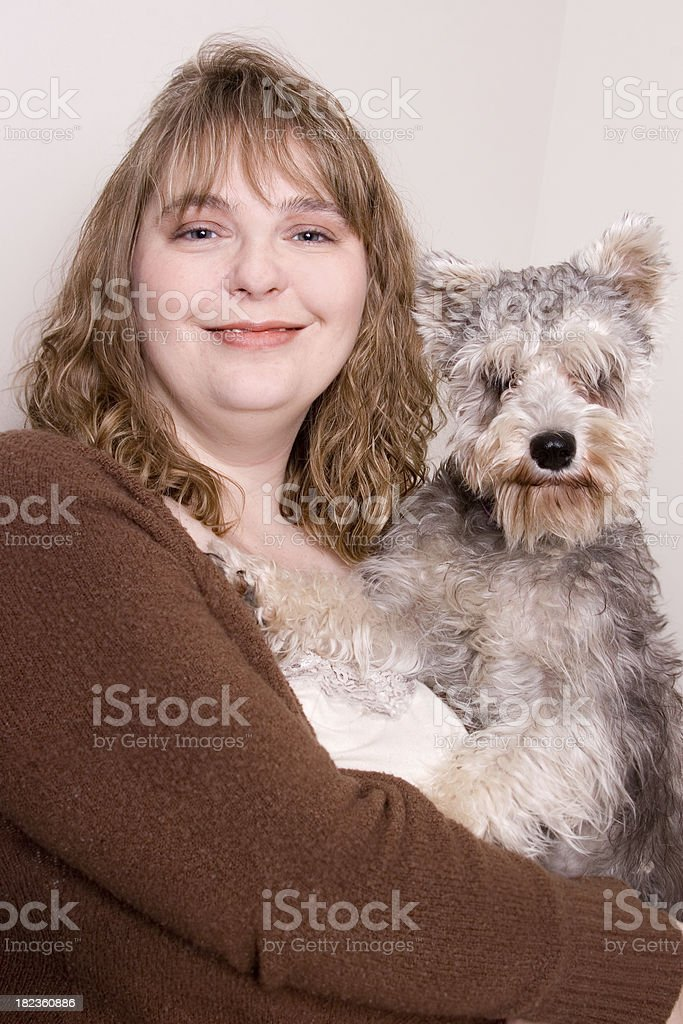 Woman with her Schnauzer royalty-free stock photo