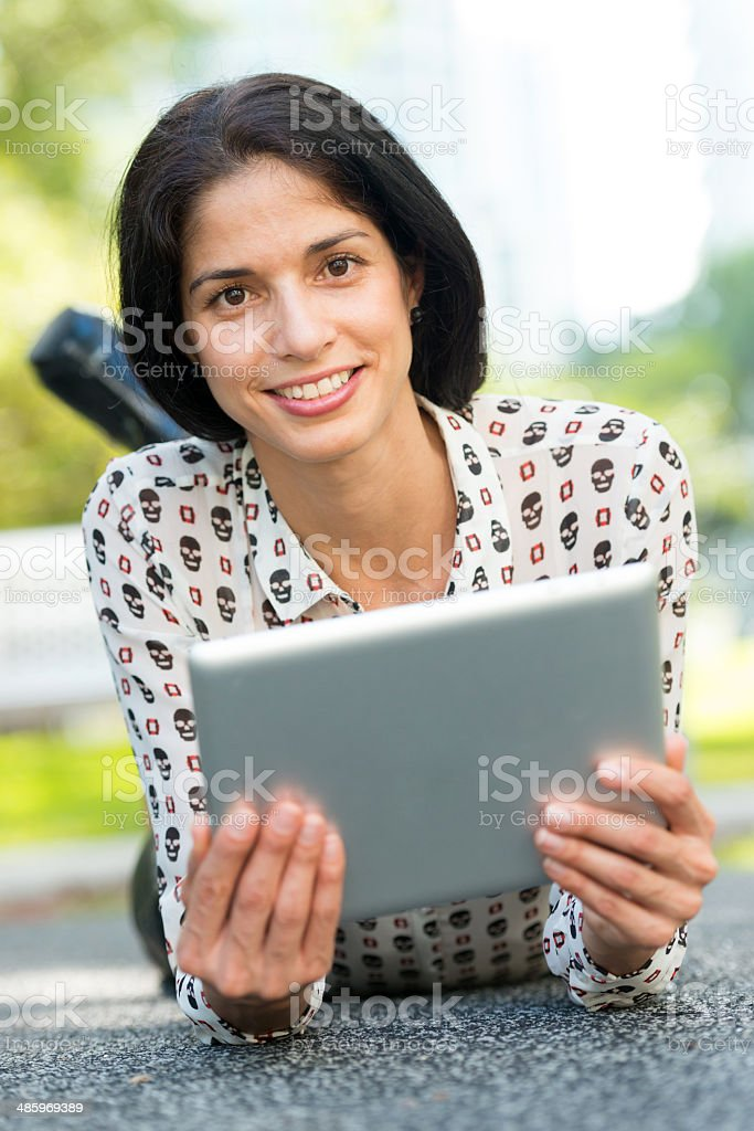 Woman with her tablet royalty-free stock photo