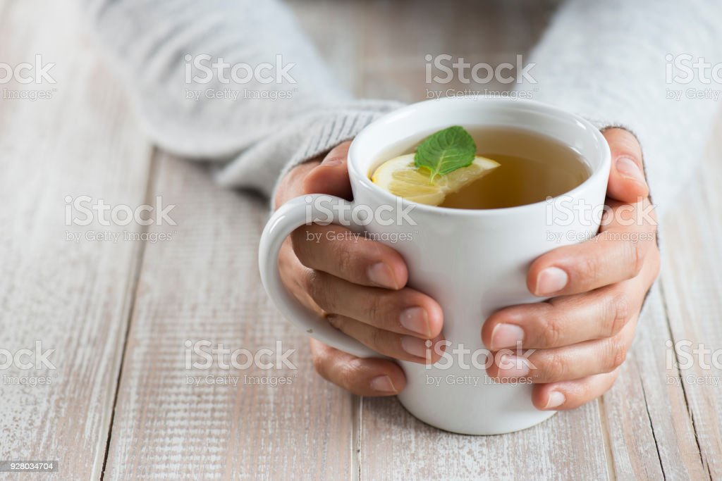 Woman with herbal tea stock photo