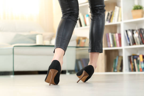 Woman with high heels walking and sprain ankle stock photo