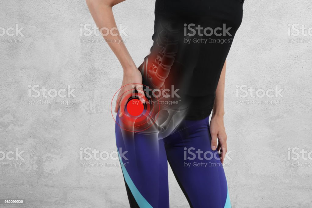Woman with hip joint pain. Sport exercising injury stock photo