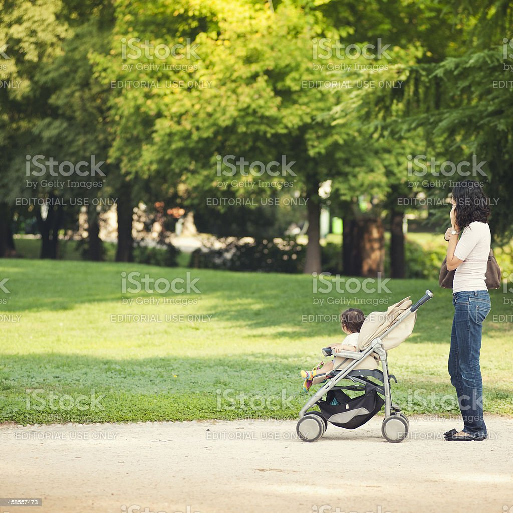 Woman with his child calling on the phone - Milan stock photo