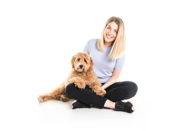 Woman with his golden labradoodle dog isolated on white background picture id1147997417?b=1&k=6&m=1147997417&s=612x612&w=0&h=fxgutz4 xbb2p7 rf5jediblz6cpxizk3g2qxrfyjxk=