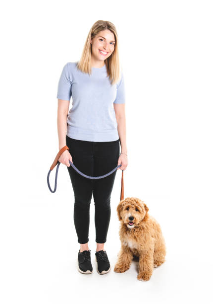 Woman with his golden labradoodle dog isolated on white background picture id1147997440?b=1&k=6&m=1147997440&s=612x612&w=0&h=ueuczgif4972c1fgpesdzgzzsm9negxa4hgtc2y2qx0=
