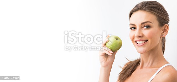 istock Woman with holding green apple 943730262