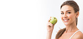 Woman with holding green apple