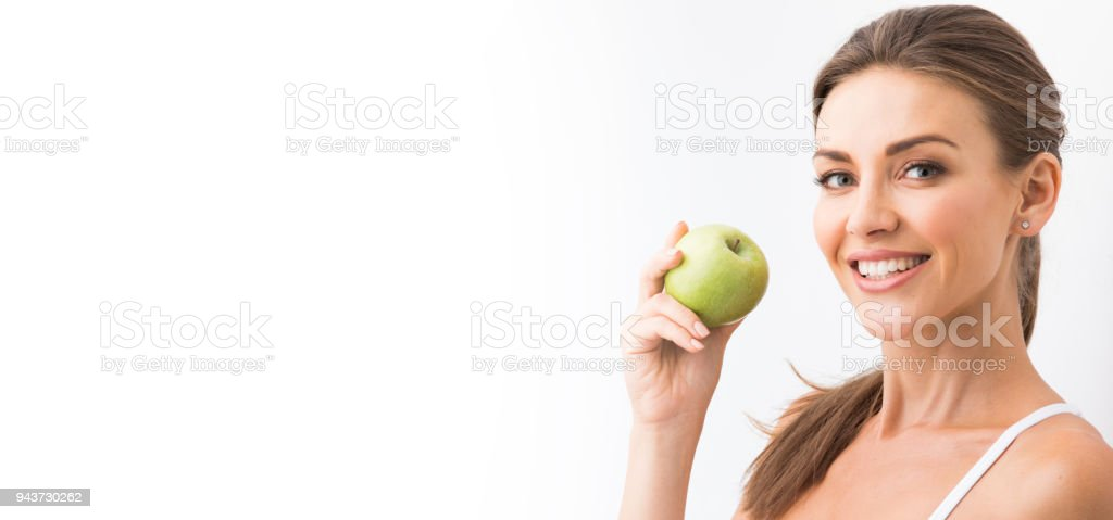 Woman with holding green apple stock photo