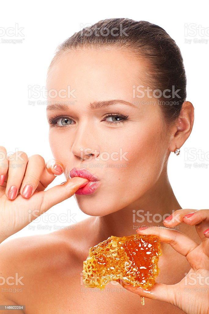 woman with honeycomb stock photo