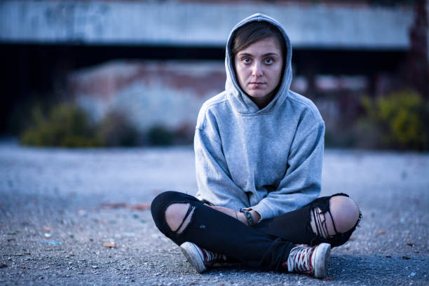 woman with hood - homelessness stock photos and pictures
