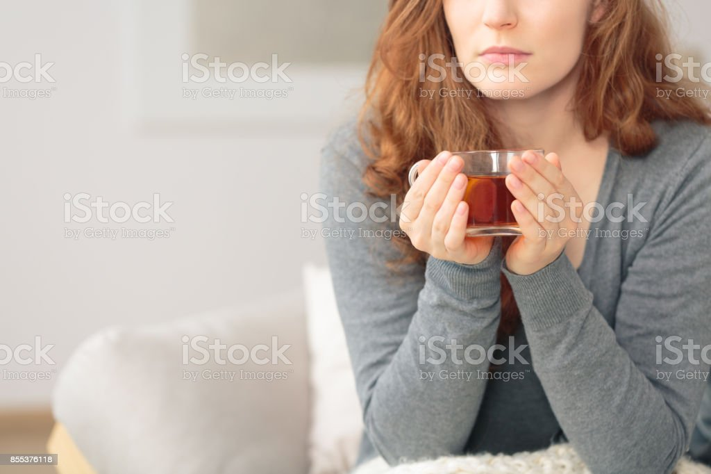Woman with hot lemon tea stock photo