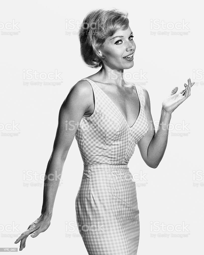 Woman with hourglass figure, wearing dress royalty free stockfoto